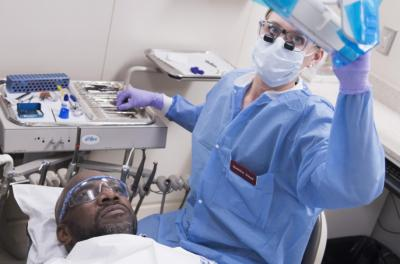 College of Dentistry student performs dental work on a patient who is a veteran