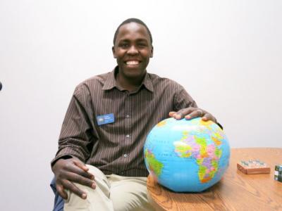 Zadok Nampala sits by a globe