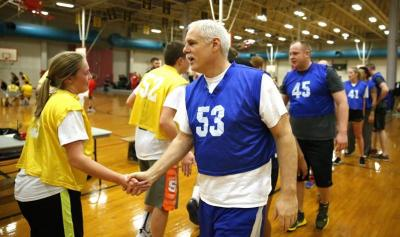 UI Public Safety Director Scott Beckner shakes hands with students after an intramural basketball game.
