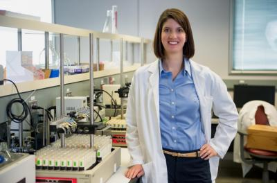 woman posing for portrait in lab setting