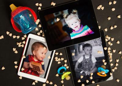 iPads with infant photos and assorted baby items