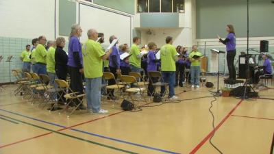 Members of the Oakdale Community Choir rehearse for an upcoming performance on Dec. 10th.