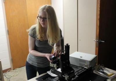 Liza Casella, 17, works with University of Iowa physics graduate student Patrick Wilcox (not pictured) at Van Allen Hall on Wednesday, July 22, 2015. Casella's research is conducted through the UI Belin-Blank Center's Secondary Student Training Program.