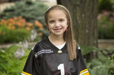 girl in Iowa football jersey