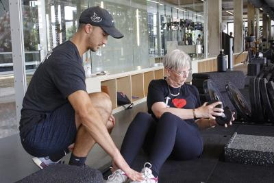 woman working with personal trainer