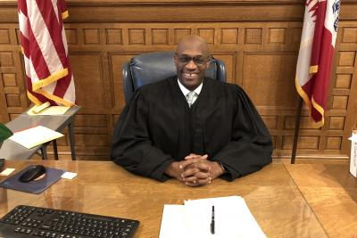 judge kevin mckeever sitting at desk