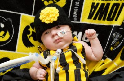 infant wearing hawkeye gear