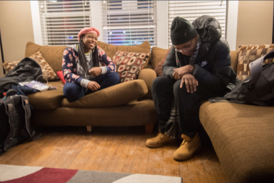 """Reanna Lewis, left, who sometimes goes by Lochemet Perach, chats and raps with Z.o.n.e. (Zones.Only.Neglect.Elevation) during a cypher at the African American Cultural Center. A cypher is an event where the """"floor is opened to anyone who wishes to rap and"""