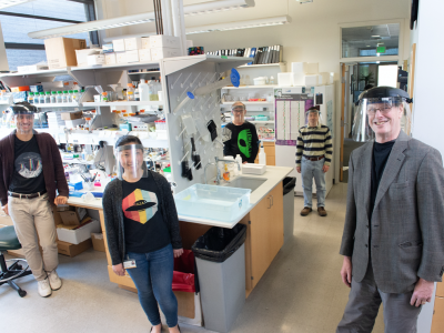 Val Sheffield (right), the Roy J. Carver Chair in Molecular Genetics in the Carver College of Medicine, with members of his research laboratory (from left) Calvin Carter, Sunny Huang, Charles Searby, and Qihong Zhang.