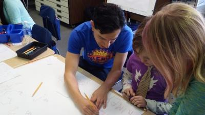 UI graduate students help at Lincoln Elementary School's Hollywood STEAM Day.