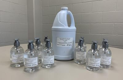 hand sanitizer created by UI Pharmaceuticals, in containers of varying sizes