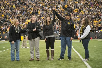 Two parents are honored on the field at Kinnick Stadium