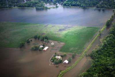 An aerial photo of a farm in the Midwest that is flooded