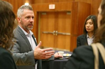 Mike Stuart of Igor talks with first and second year MBA students as the Tippie School of Management students have their initial meeting with their clients at the Iowa Memorial Union in Iowa City on Friday, Dec. 5, 2014.