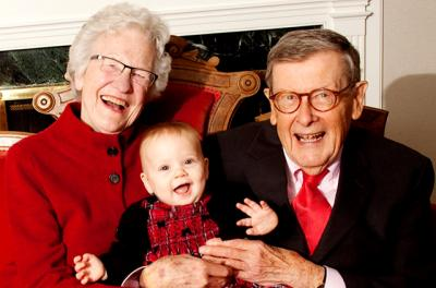 man and woman with great-grandchild