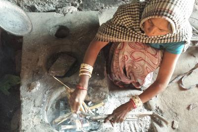 woman using cookstove