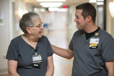 Dan Lose interacts with another nurse at university of iowa hospitals and clinics