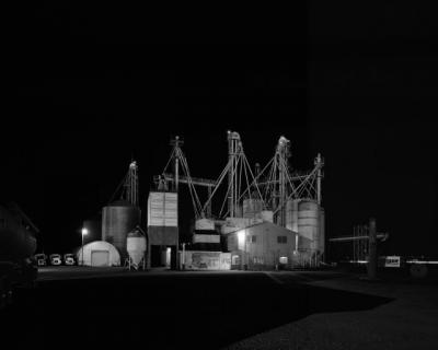 photo of industrial manufacturing plant at night