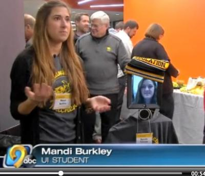 UI student Mandi Burkley shows off a double robot.