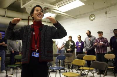 UI assistant professor Mary Cohen leads inmates and community volunteers during a practice with the Oakdale Prison Community Choir, Tuesday, March 3, 2009, at the Iowa Medical & Classification Center, in Coralville, Iowa.
