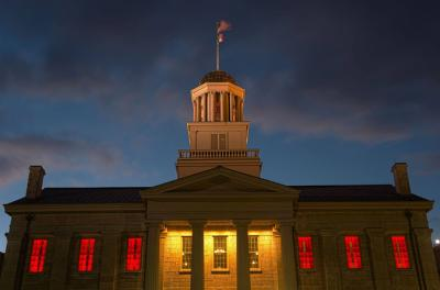 old capitol museum with windows lit in red