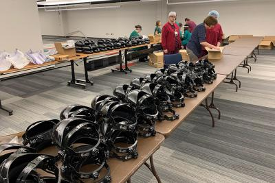 University of Iowa Hospitals & Clinics staff assemble a batch of face shields