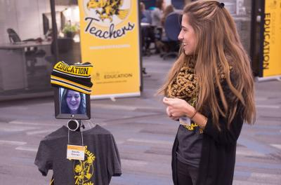 student with ipad/robot combo