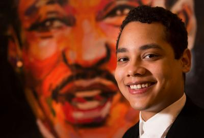color portrait of Sam Watkins in front of MLK portrait