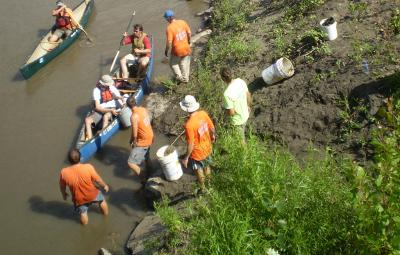 canoeists and event staff participate in the Project AWARE team that cleaned up the East and West Nishnabotna Rivers during 2010.