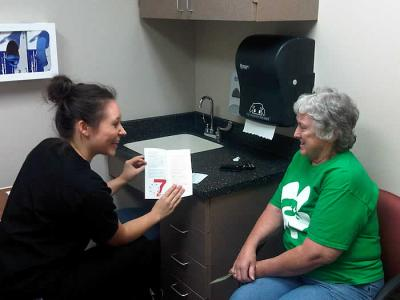 A UI nursing student works with a senior citizen through the RSVP partnershiop with the College of Nursing