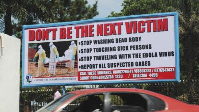 A billboard in Liberia's capital Monrovia offers advice on how to halt the spread of Ebola. (Source: PRI)