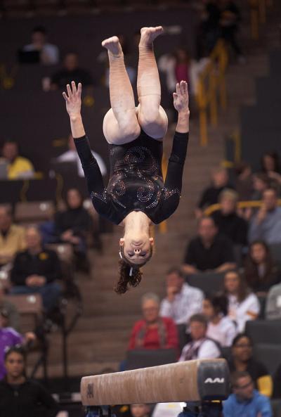 Iowa gymnast competes on beam.