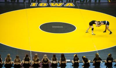 two wrestlers on gold IOWA mat