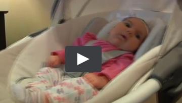 infant in swing