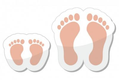 Illustration of baby feet next to an adult woman's feet, Image Credit: RedKoala / Shutterstock
