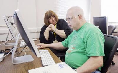 Dolores Ratcliff of Iowa City (left) guides Mike Bray of Iowa City during a computer mentoring session at the Iowa City Senior Center on Wednesday, June 19, 2013, in Iowa City. Ratcliff is a volunteer mentor at the center, teaching seniors one-on-one how