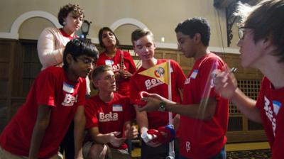 team of students from West Des Moines Valley High School feel the weight of plastic rigs and take notes at the FIRST Tech Challenge kickoff at the Iowa Memorial Union in Iowa City on Sept. 8, 2012. (Liz Martin/The Gazette-KCRG)