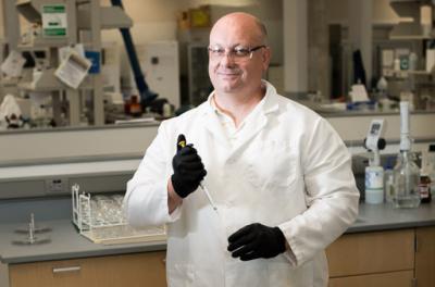 portrait of Steve Bernholtz in his lab