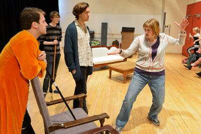 Kristin Clippard works with actors during rehearsal