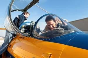 Tom Schnell, an associate professor at the University of Iowa, helps prepare an Aero L-29 Delfin for flight at the Iowa City airport. The jet, part of the university's Operator Performance Laboratory, has been used by companies to test equipment for the l