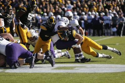 Travis Perry tackling Justin Jackson on the football field