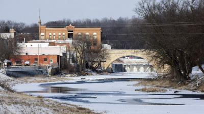 The Turkey River runs through Elkader, beneath the Keystone Arch Bridge, on Wednesday, Jan. 23, 2013. The river has flooded several times in recent decades, including a high water level more than 15 feet over flood stage in 2008. The bridge is the longest