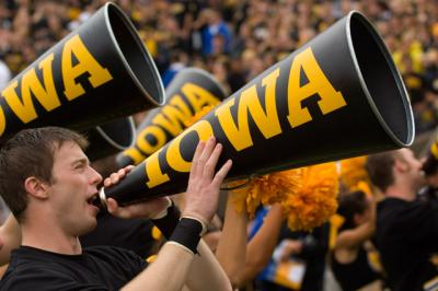 A football cheerleader yelling into a megaphone