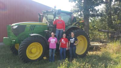 Four UI nursing students learn about public health issues at an area farm