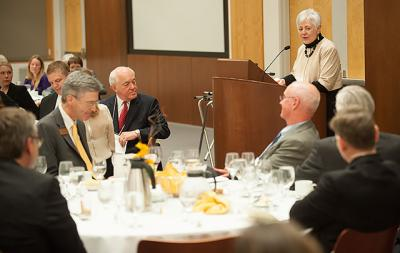 President Mason speaks to a group of award winners