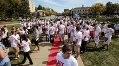 Men don high heels in a University of Iowa fund-raising walk to end sexual violence