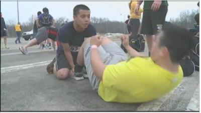 UI student veterans participate in the 2nd Annual Warrior Challenge by doing sit ups during the race.