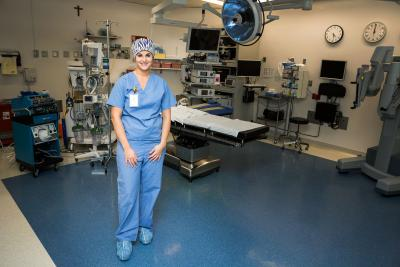 portrait of Jennier Ortega in an operating room wearing blu scrubs