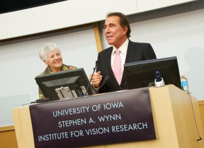 Sally Mason and Stephen Wynn at podium