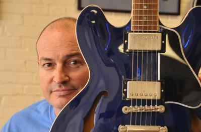 Jay Sieleman poses with a guitar